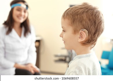 Little boy with hearing aid in otolaryngologist's office