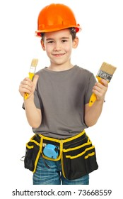 Little boy with helmet showing two paint brushes isolated on white background