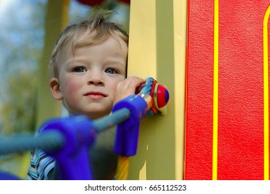 Little boy is hiding on the playground. Child concept
