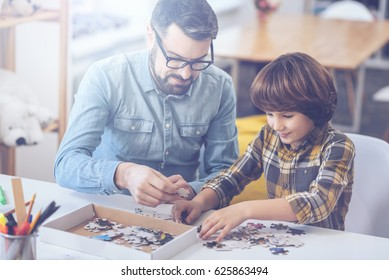 Little boy and his father playing in family circle