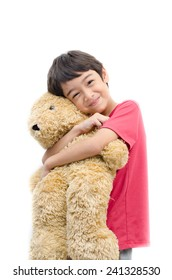 Little boy hold teddy bear on white background