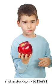 Little boy holding and apple and looks tired of  to much eating apples or not like this fruit  isolated on white background