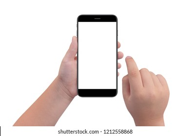 Little boy holding black modern smartphone with empty screen in hand, isolated on white background. Mockup