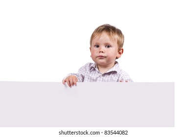 Little boy holding an empty board. Isolated on white.