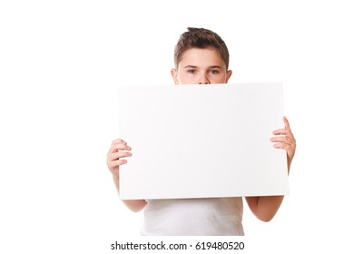 little boy holding a large white plate for your text