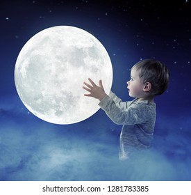 Little boy holding the moon