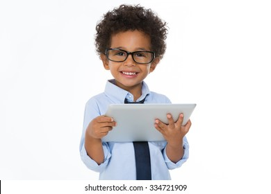 little boy holding a notepad and smiling isolated on white background