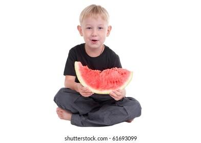 Little boy holding a slice of watermelon