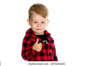 Little boy is holding a thumbs up, in studio on a white background. The concept of emotion and the assertion of something, a happy childhood. Isolated.