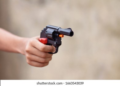 Little boy holding the toy gun on Diwali Occasion