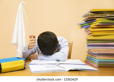 little boy holding white flag, exhausted by doing homeworks