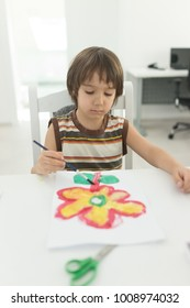 Little boy at home drawing and playing