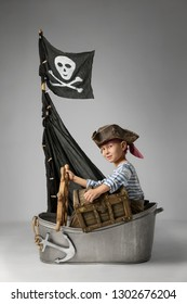Little boy imagine themselve as pirate searching for treasure on the ship