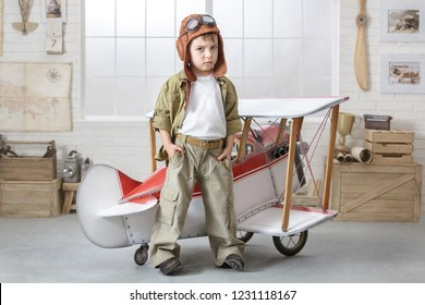 Little boy imagines himself as an airplane pilot in the children's room