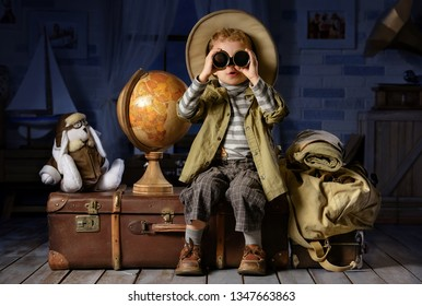 Little boy imagines himself a tourist and plays in his room