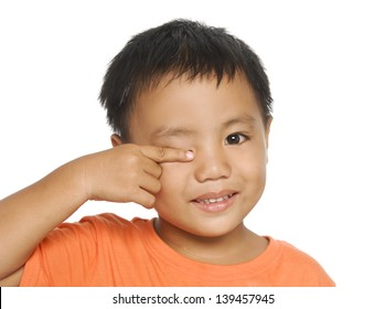 Little boy ins raising finger gesture on eye