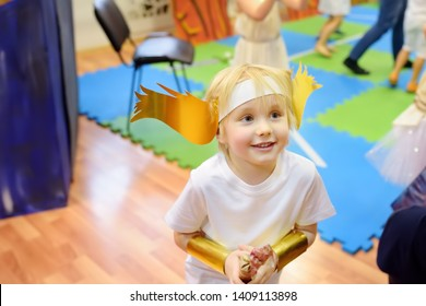 Little boy involved in performance children's theatre Studio . Child perform kids playing greek heroes on stage in theater.
