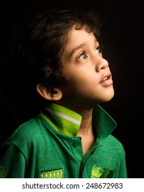 little boy isolated in black background