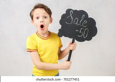 Little boy isolated on white studio portrait