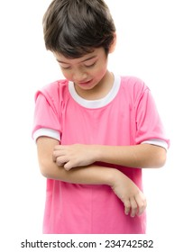 Little boy itchy his arm on white background