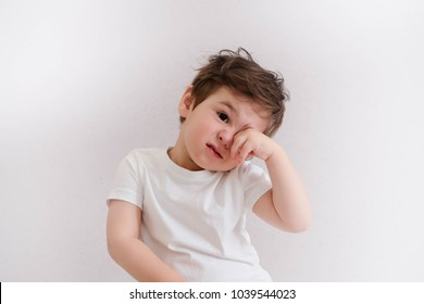 Little boy itchy his eyes with tear