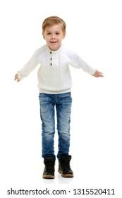 Little boy jumping fun in the studio on a white background. The concept of a happy childhood, sports and fitness. Isolated.