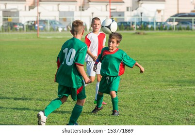 little boy kicking the ball with head