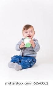 Little boy with kid's mug