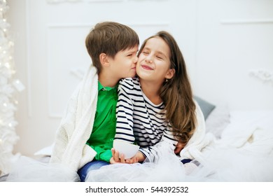Little boy kissing girlfriend. The concept of love and Valentine's Day.
