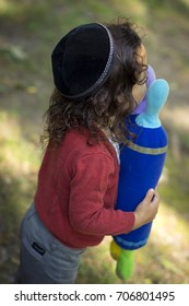 little boy kissing plush torah