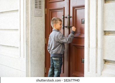 Little boy knocking the door