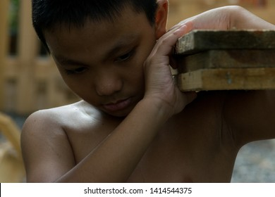Little boy labor working in commercial building structure, World Day Against Child Labour concept or Children violence and abused concept.