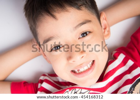Little Boy Laying Down On Floor Stock Photo (Edit Now) 454168312 ... 48110672d3d1b