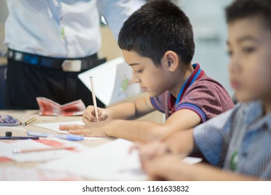 Little boy learn how to make light power