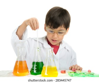 Little boy learning in chemical in science in class