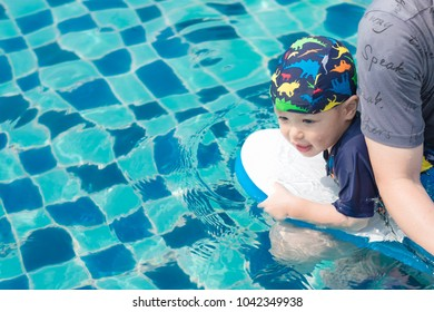 Little boy learning to swim with his father. Background. Copy space.