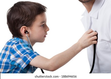 Little boy learning to use stethoscope during visit in doctor's office