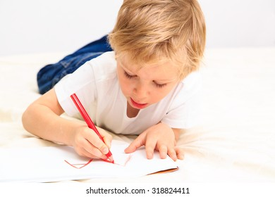 little boy learning to write letters, early education