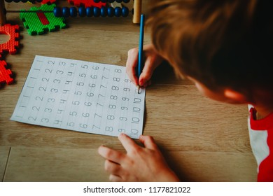 little boy learning to write numbers, arithmetic, abacus calculation