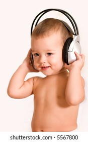 Little boy listening by headphone