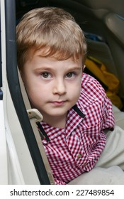 Little boy looking from the car