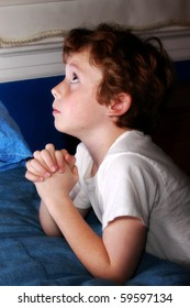 little boy looking up and praying