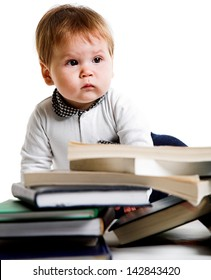 little boy with lots of books