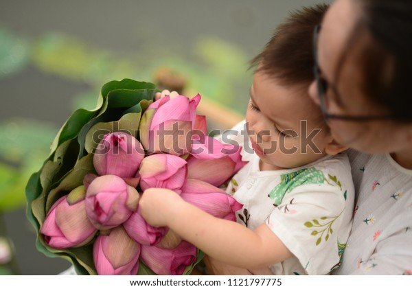 Little boy and lotus flower