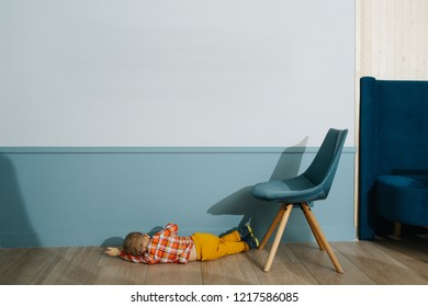 Little boy lying on the floor and playing