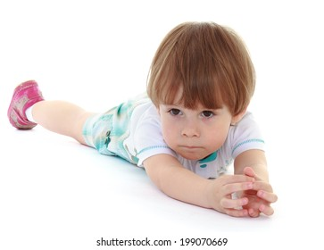 Little boy lying on his stomach.Isolated on white background.