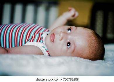 Little boy lying on his bed
