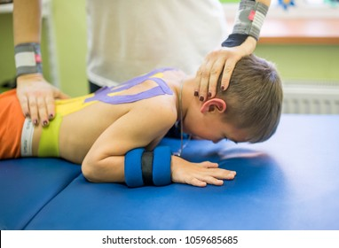little boy lying on stomach during physiotherapy