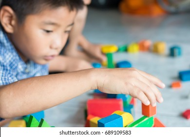Little boy made toy blocks, activity therapy after splinting arm