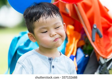 Little boy make a funny face